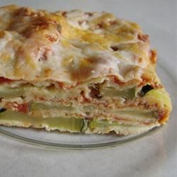 Zucchini Parmigiana Recipe - Breaded zucchini slices are layered with tomato sauce, ricotta cheese, and mozzarella!