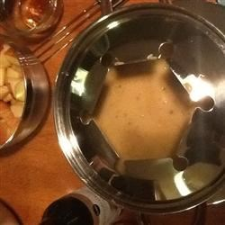 Beer Cheese Fondue Recipe - This two-cheese beer fondue is perfect for dipping French bread cubes and vegetables.