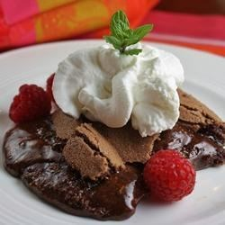 Swedish Sticky Chocolate Cake (Kladdkaka) Recipe - This rich and gooey chocolate cake is made with pantry staples and baked in a pie plate. Delicious served warm or cold.