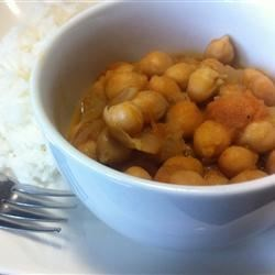 Indian Chickpeas Recipe - Garbanzo beans, onions, and spices are simmered together in this typical Northern Indian recipe that is easy to make, and delicious.  You will need to go to an Indian grocery to buy the masalas.