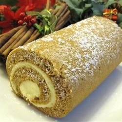 Pumpkin Roll Recipe - This is a great dessert, especially nice for holidays, but it can be served anytime of the year.  The resulting pumpkin roll slices will impress your guests.  The pumpkin roll is not as hard to make as it sounds.  Be sure and use plain canned pumpkin and not pumpkin pie mix. Originally submitted to CakeRecipe.com.