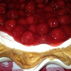 Cherry Dessert Recipe - A graham cracker crust is filled with a creamy sweet concoction and topped with cherry pie filling, to make this easy-to-make, no-bake pie. Best served chilled.