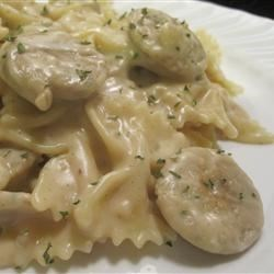 Garlic Sausage and Pasta in a Bechamel Sauce Recipe - Garlic chicken sausage is tossed with corkscrew-shaped pasta in a creamy sauce for quick and easy Italian-inspired dinner.