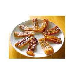 Fried Plantains Recipe - Fried plantains are a traditional treat in many parts of the world. Try them once and you'll be hooked. Overly ripe plantains work best for this recipe.
