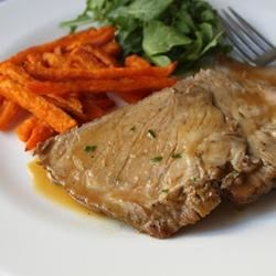 Slow Cooker Apple Cider Braised Pork Recipe - This pork shoulder recipe combines pork shoulder with apple cider in a slow cooker, where it is cooked for several hours until tender. Reduce the cooking liquid to create a thick and flavorful sauce you can pour over the sliced pork.