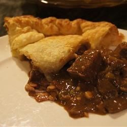 Beef, Mushroom and Guinness(R) Pie Recipe - Beef, mushrooms, and Irish stout beer simmer into a savory filling for a pot pie topped with puff pastry.