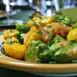 Skillet Summer Squash Recipe - Yellow or pattypan squash are pan-fried with bacon and onions for a quick and savory side dish at breakfast, lunch, or dinner.