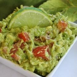 Easy Guacamole Recipe - Avocados, onion, chopped tomato, garlic and a splash of lovely lime juice. That's all. Well, maybe a dash of salt and pepper and an hour or so in the refrigerator. Fabulously easy.