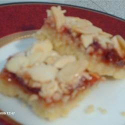 Almond Bars I Recipe - These bars taste wonderful and are very colorful on your plate of goodies for the holidays.  Try them and your guests will rave over them. Don't be surprised if they ask you for the recipe.