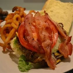Bacon Cheeseburgers Recipe - This takes a little more effort than the average cheeseburger, but is well worth it! Serve on buns with your favorite condiments.