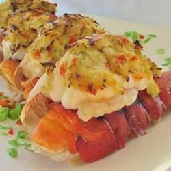 Crab Stuffed Lobster Rayna Recipe - Grilled lobster tails stuffed with celery, green onion, and crabmeat seasoned with cayenne pepper and dry mustard. Delicious served with warm garlic lemon butter.