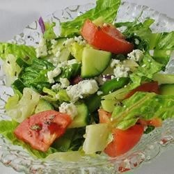 Greek Salad V Recipe - Here is a recipe you'll love for its simplicity and wonderful flavor! Layers of cucumber, tomato, red onion, and green pepper are sprinkled with kalamata olives, feta cheese and oregano, then drizzled with lemon juice and olive oil.
