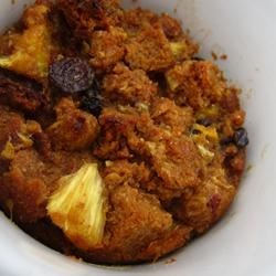 Pineapple Bread Pudding with Raisins Recipe - This sweet and fruity bread pudding has pineapple chunks, raisins, and walnuts dotted throughout. Serve it with a scoop of ice cream for a dessert your whole family will enjoy.