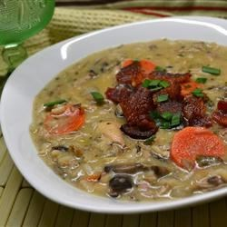 Turkey Wild Rice Soup II Recipe - Use your left-over turkey to make a surprisingly elegant cream soup full of tender wild rice and turkey, simmered in broth enriched with half-and-half. Slivered almonds add crunch.