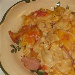 Kielbasa Pasta Casserole Recipe - An irresistible, quick, and easy casserole with kielbasa, ziti and tomatoes and topped with Monterey Jack cheese.