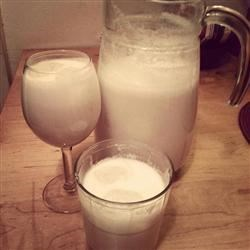 Coconut Horchata Recipe - Rice, almonds, and coconut are ground and soaked in water, then sweetened with condensed milk and coconut milk in this tropical drink.