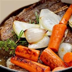 Stove Pot Roast With Mashed Potatoes Recipe - Simmer a pot roast with onions and carrots on your stove and serve the meat with with buttery mashed potatoes.