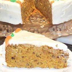 Carrot Walnut Cake Recipe - A carrot cake that is moist, but not oily. The cream cheese frosting is delicious and does not form a crust.