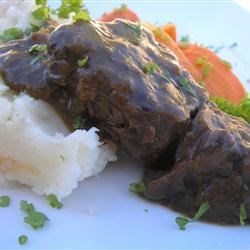 Beef Short Ribs Sauerbraten Recipe - The 24-hour marinade in this classic German dish, Sauerbraten, ensures succulent short ribs have that signature tanginess. Gingersnaps give the sauce a beautiful texture and add a sweet spiciness.