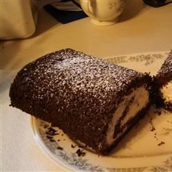 Chocolate-Banana Cake Roll Recipe - A very thin chocolate cake with whipped cream and a banana rolled inside is covered with chocolate frosting for a lovely dessert any time of year.