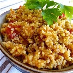 Mango Salsa Couscous Recipe - Spice up your couscous with curry powder, dried mango, and salsa for a Moroccan-inspired side dish.