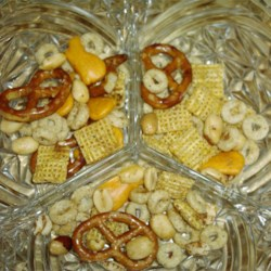 Nuts and Bolts Party Mix Recipe - You can buy pre-packaged party mix if you so choose, but this home-made version--with the classic seasoned ingredients--is even better. Especially when warm from the oven.