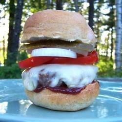 Jalapeno-Blue Cheese Burgers Recipe - Blue cheese, jalapeno and Swiss cheese round out these huge grilled burgers. These delicious burgers will make you think twice about eating chicken!