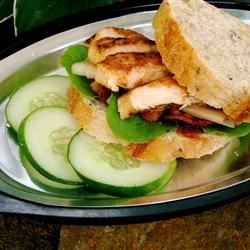 Dan's Favorite Chicken Sandwich Recipe - BBQ sauce and bacon are the secrets to the wonderful flavor of the chicken in this sandwich.  Add avocado and cheese, and how can you go wrong? Makes a hearty lunch by itself or serve with salad or french fries for a delicious dinner.