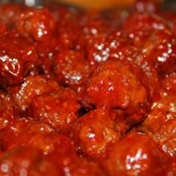 Cape Cod Cocktail Meatballs Recipe - Sweet and tangy cocktail meatballs are baked in a fruity and colorful cranberry sauce glaze in this recipe that originated on Cape Cod.