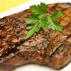Sirloin Steak with Garlic Butter Recipe - What's better than a sirloin steak cooked to perfection on the grill? A sirloin steak cooked to perfection on the grill and then brushed with this yummy butter sauce laced with lots of garlic!