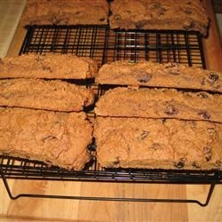 Hermit Bar Cookies Recipe - Spicy molasses cookies with a hint of coffee are baked in long strips then cut into bars after baking.