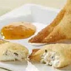 Crab Rangoon Puffs Recipe - Crescent roll dough is filled with a mixture of crab meat, cream cheese, and cocktail sauce, then baked to a golden brown. This is a tasty treat that has a flavor similar to Crab Rangoon. These crab puffs are a great appetizer for any occasion. You may want to make a second batch!