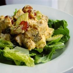 Fruited Curry Chicken Salad Recipe - Diced chicken dressed with curry mayonnaise sports a wonderful assortment of apple, raisins and grapes, plus celery, onion and pecans for savory crunch.