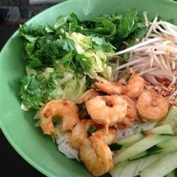 Vermicelli Noodle Bowl Recipe - Many Vietnamese dishes are perfect for hot weather. This simple noodle salad combines fresh herbs, rice vermicelli, cucumber, bean sprouts, and more, topped with grilled shrimp. Tossed with a tangy sweet and sour sauce, it's a simple and satisfying dinner.