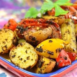Moroccan Potato Casserole Recipe - A lemon/vinaigrette sauce is made with lots of fresh spices blended in. Chunks of tomatoes, bell peppers and celery are tossed with the herb sauce and baked until the vegetables are tender, and have absorbed all the liquid.