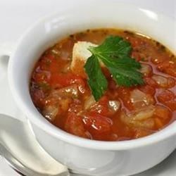 'No Soup For You' French Tomato Soup Recipe - When the gardens and farmers' markets are bursting with fresh ripe tomatoes, make this French-inspired tomato soup flavored with basil, oregano, thyme, and a sprinkling of cinnamon. A spoonful of Gorgonzola cheese tops every bowl.