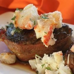 Mouthwatering Crabmeat Pan Seared Filets Recipe - Pan-seared beef filets topped with crabmeat is the perfect romantic dinner for two.