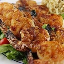 Spicy Grilled Shrimp Recipe - So fast and easy to prepare, these shrimp are bound to be the hit of the barbeque. And, weather not permitting, they work great under the broiler, too.