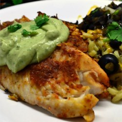 Crispy Chipotle Lime Tilapia with Cool Avocado Sauce Recipe - You will love this zesty Southwestern-style fish. If you have any leftovers, they make great fish tacos.