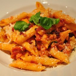 Penne a la Vodka II Recipe - Tomatoes simmered with garlic, basil, vodka and cream and tossed with penne.
