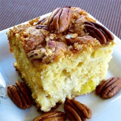 Pecan Pineapple Coffee Cake Recipe - Pineapple bits and pecans give this coffee cake a tropical taste, and it's a delicious accompaniment to a hot cup of coffee or tea.