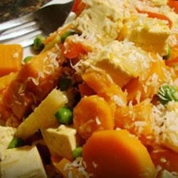 Bombay to Bangkok Vegetable Curry Recipe - Fragrant ginger, lime leaves, and curry powder in a medley of fresh veggies with tofu bring exotic flavors to this vegetarian curry dinner.