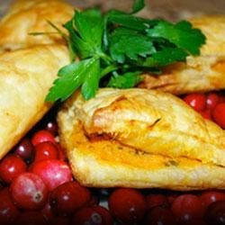 Sweet Potato Turnovers Recipe - These puff pastry turnovers are filled with a creamy mixture of sweet potato, garlic, and thyme.