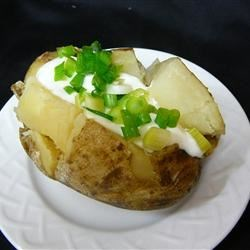 Slow Cooker Baked Potatoes Recipe and Video - Use your slow cooker to make tender baked potatoes while you attend to other things.