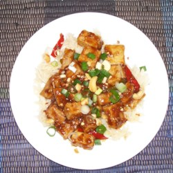 Tofu with Pork and Cashews Recipe - Warm and spicy, this stir fry will really wake up your tastebuds. The tofu takes on the wonderful flavors of the sauce. Serve with stir-fried vegetables.