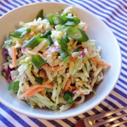 Donna Leigh's Creamy Broccoli Slaw Recipe - Toasted almonds and ramen noodles are tossed in a creamy dressing for an addictive summer salad.