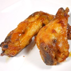 Big Game Hot Wings Recipe - Sweet and spicy baked chicken wings are coated with a zesty sauce flavored with an orange.