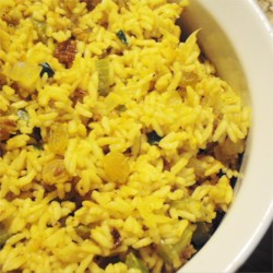 Rice Pilaf with Raisins and Veggies Recipe - This savory rice dish is dotted with sweet golden raisins for a light fruity flavor.