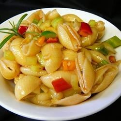 Tenia's Chilled Pasta Salad Recipe - Multi-colored pasta and bits of green pepper, tossed with a sweetened vinegar and oil dressing make a salad that tastes as wonderful as it looks.  Makes six generous servings.