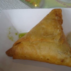 Cheese Sambusa Recipe - Three cheeses are stuffed in a buttered pastry wrapper with cilantro and garlic for a savory, Middle Eastern-inspired snack.